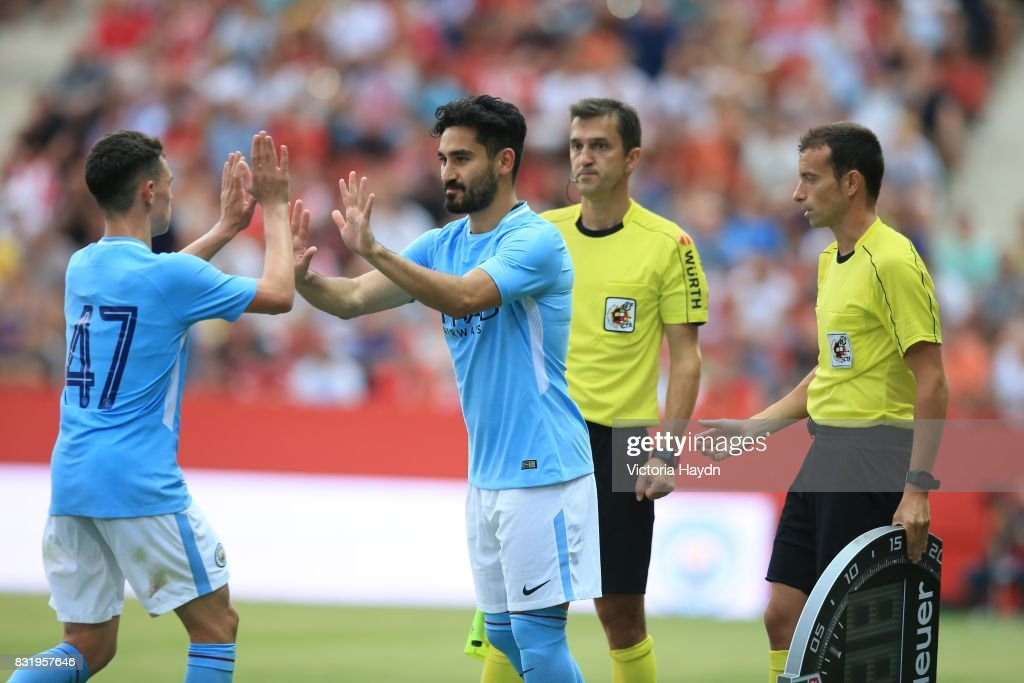 http://media.gettyimages.com/photos/phile-foden-of-manchester-city-comes-off-for-ilkay-gundogan-of-city-picture-id831957646