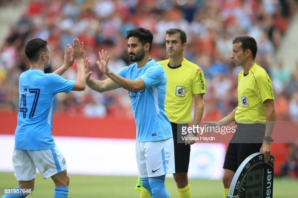 Phile Foden of Manchester City comes off for Ilkay Gundogan of Manchester City during the preseason friendly match between Girona and Manchester City...