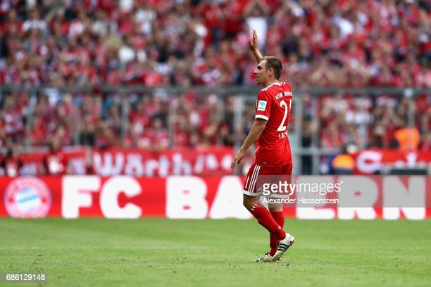 Philiip Lahm of Bayern Muenchen leaves the field of play and is substituted on his last match during the Bundesliga match between Bayern Muenchen and...