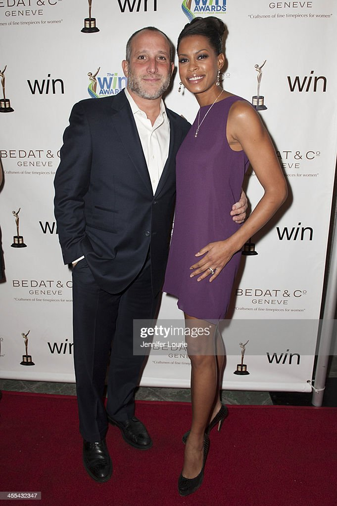 Philip Ambrosino and actress Kearran Giovanni arrives at the annual 2013 Women's Image Awards at Santa Monica Bay Woman's Club on December 11, 2013 in Santa Monica, California.