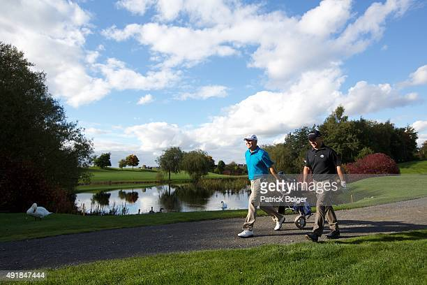 Philip Archer and Robert Coles walk from the 3rd tee at Mount Wolseley Hotel Spa and Golf Resort on October 8 2015 in Carlow Ireland