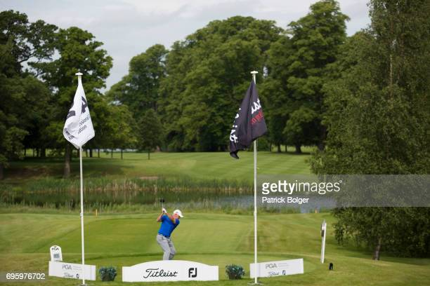 Philip Archer from Birchwood Golf Club plays his tee shot on the 1st hole during the Titleist and Footjoy PGA Professional Championship at...