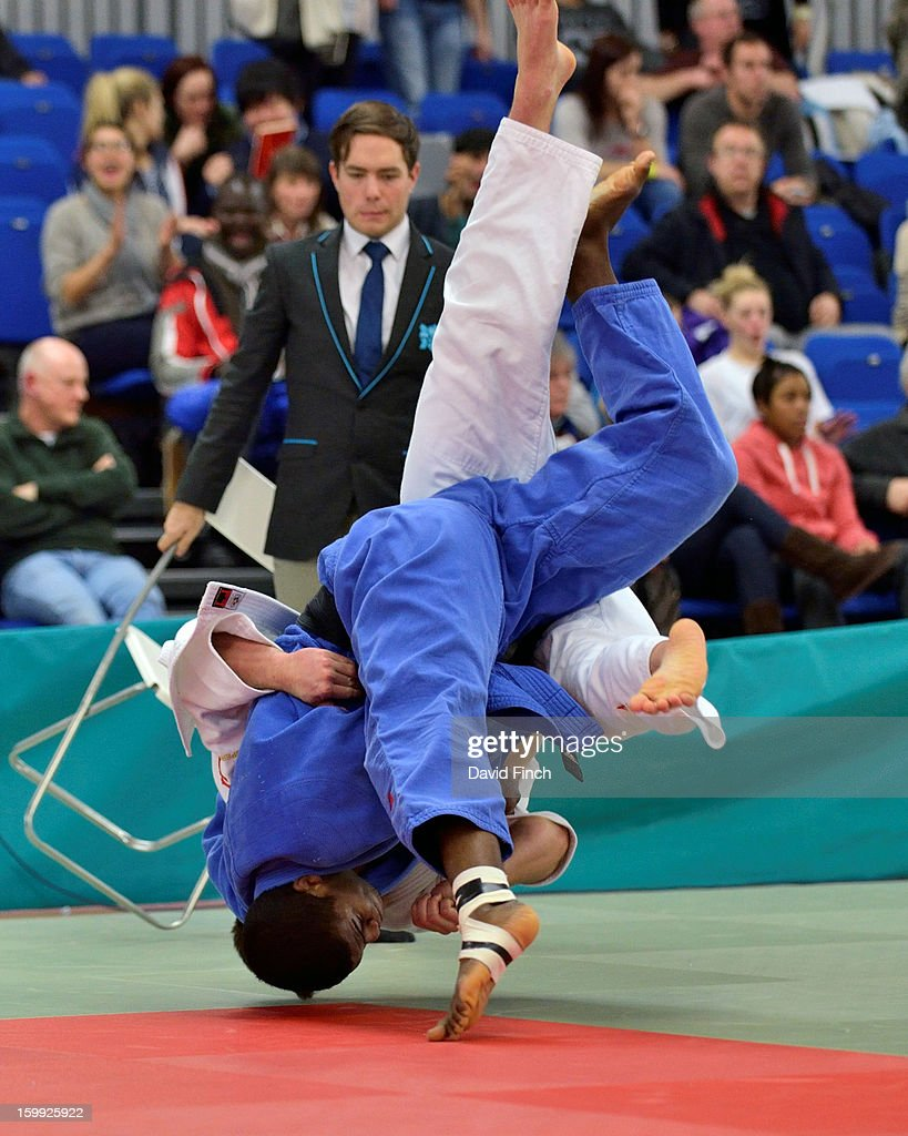 Philip Awiti-Alcaraz from Ealing (blue) pushed Ben Fletcher into second place by throwing Fletcher for ippon in their u100kgs final pool match at the British Senior Judo Championships on Sunday, January 20, 2013 at the English Institute of Sport, Sheffield, England, UK.