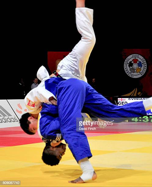 Philip AwitiAlcaraz of Great Britain throws Beka Gviniashvili of Georgia for an ippon to win teir u100kg opening contest during the Paris Grand Slam...