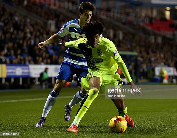 Philip Billing of Huddersfield holds off pressure from Lucas Piazon of Reading during the Sky Bet Championship match between Reading and Huddersfield...