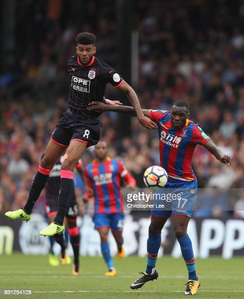 Philip Billing of Huddersfield Town battles with Christian Benteke of Crystal Palace during the Premier League match between Crystal Palace and...