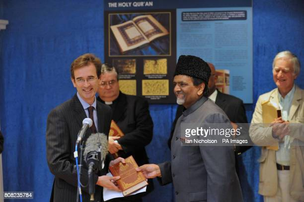 Philip Breeden Press Counsellor at the US Embassy London receives a Koran from Mr Rafiq Hayat National President at a multifaith gathering at the...