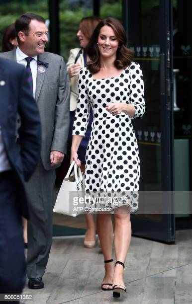 Philip Brook Chairman of the All England Lawn Tennis Club chats with Britain's Catherine Duchess of Cambridge as she visits The All England Lawn...
