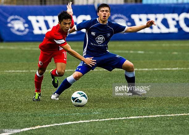 Philip Chan Siu Kwan of HKFA Dragons and Michael Lin of Hong Kong Football Club fight for the ball on day two of the Hong Kong International Soccer...