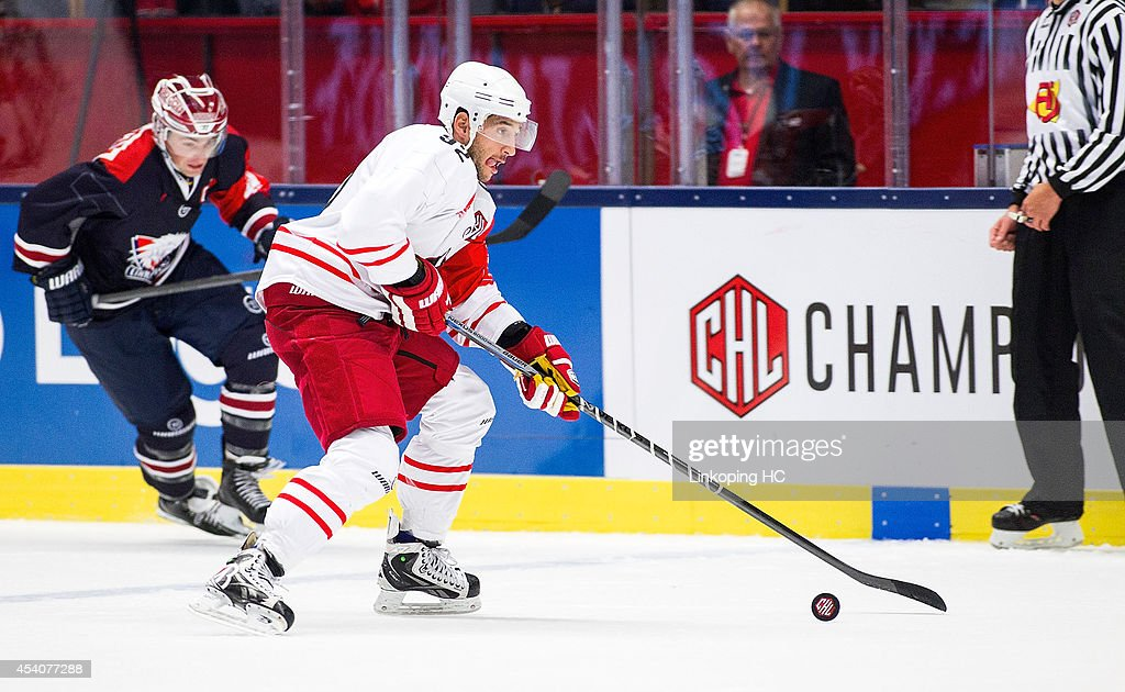 Philip DeSimone #92 of HC Bolzano handles the puck during the Champions Hockey League group stage game between Linkoping HC and HC Bolzano on August 24, 2014 in Linkoping, Sweden.