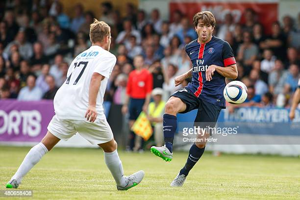 Philip Dimov of Wiener Sportklub competes for the ball with Maxwell Scherrer Cabelino Andrade of Paris SaintGermain during the Friendly Match between...