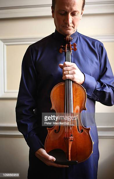Philip Dukes holds a rare 'Archinto' Stradivarius Viola at The Royal Academy of Music on March 9 2011 in London England Mr Dukes will celebrate the...