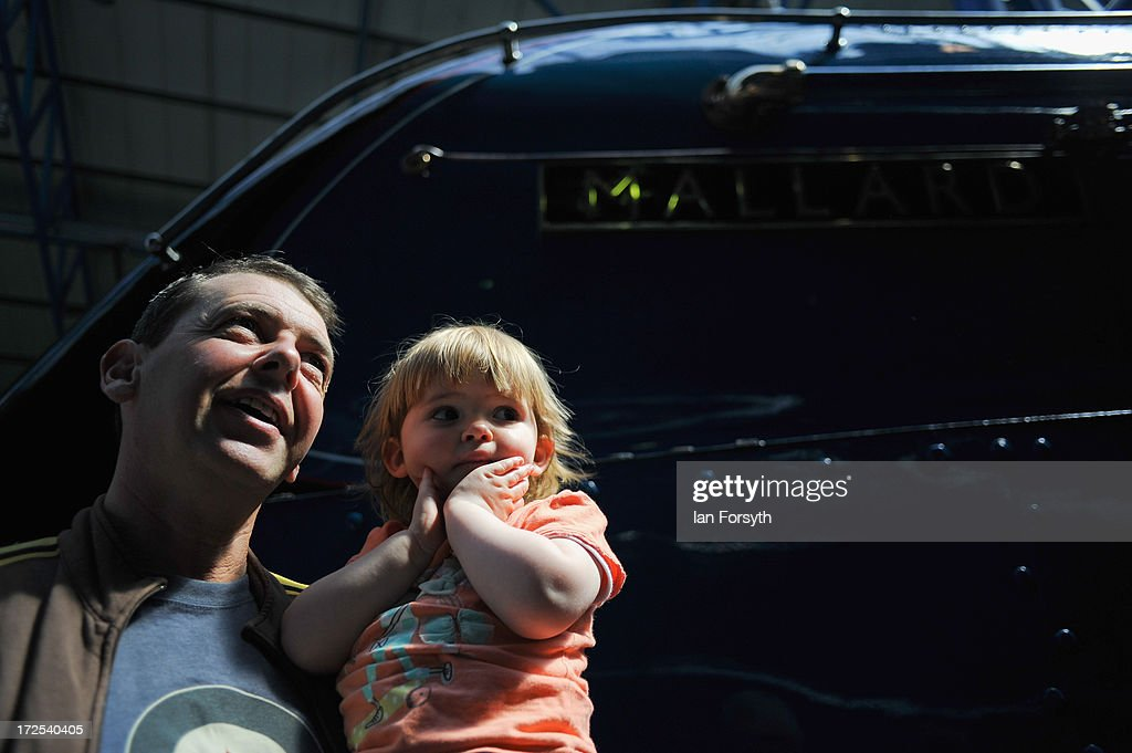 Philip Eaton and his daughter, Sophie, 2, from Selby look on at the Mallard locomotive at the National Railway Museum on July 3, 2013 in York, England. The National Railway Museum's 'Great Gathering' marks 75 years since the world's fastest steam locomotive, Mallard, is reunited with its five sister locomotives on the anniversary of its world record breaking run in 1938 where the Doncaster built steam legend raced into the record books at Stoke Bank near Grantham. The other locomtovies were Sir Nigel Gresley, Dwight d Eisenhower, Union of South Africa, Bittern and the Dominion of Canada.