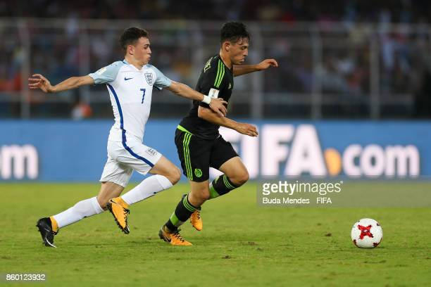 Philip Foden of England battles for the ball with Alexis Gutierrez of Mexico during the FIFA U17 World Cup India 2017 group F match between England...