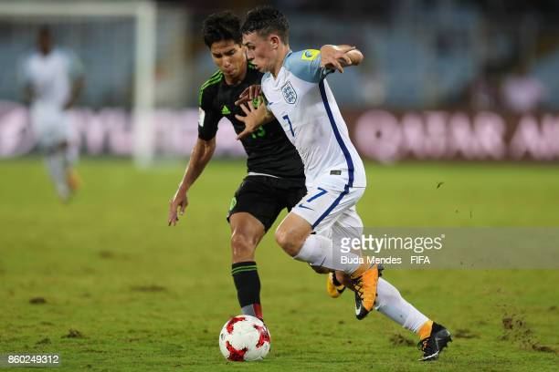 Philip Foden of England battles for the ball with Diego Lainez of Mexico during the FIFA U17 World Cup India 2017 group F match between England and...