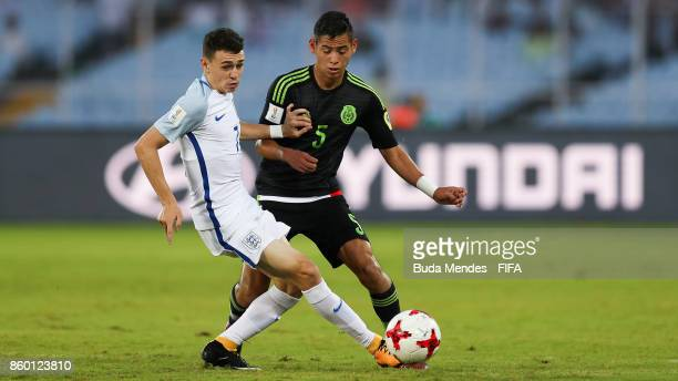 Philip Foden of England battles for the ball with Raul Sandoval of Mexico during the FIFA U17 World Cup India 2017 group F match between England and...