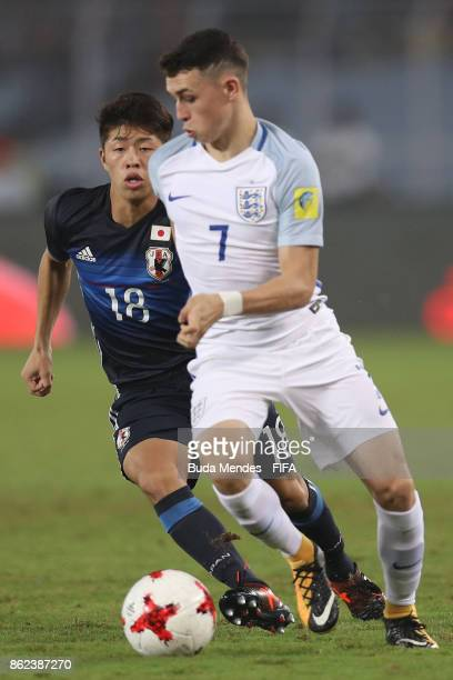 Philip Foden of England battles for the ball with Toichi Suzuki of Japan during the FIFA U17 World Cup India 2017 Round of 16 match between England...