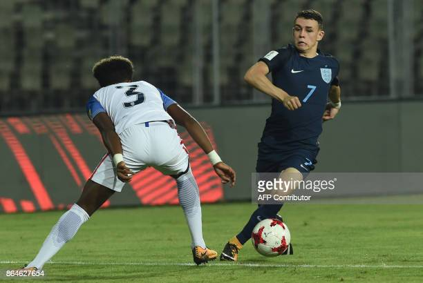 Philip Foden of England dribbles past Chris Gloster of USA during the quarterfinal football match between USA and England in the FIFA U17 World Cup...