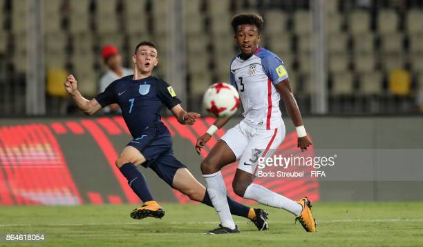 Philip Foden of England is challenged by Chris Gloster of the United States during the FIFA U17 World Cup India 2017 Quarter Final match between USA...