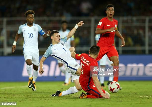 Philip Foden of England takes a shot at goal under pressure from Yerco Oyanedel of Chile during the FIFA U17 World Cup India 2017 group F match...