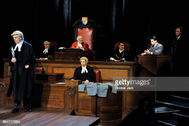 Philip Franks as Mr Myres QC and Jack Mullen as Leonard Vole with artists of the company in a production of Agatha Christie's Witness for the...