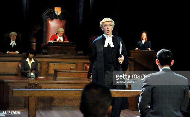 Philip Franks as Mr Myres QC with artists of the company in a production of Agatha Christie's Witness for the Prosecution directed by Lucy Bailey at...