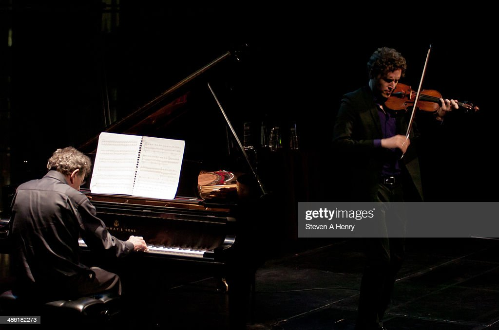 <a gi-track='captionPersonalityLinkClicked' href=/galleries/search?phrase=Philip+Glass&family=editorial&specificpeople=241461 ng-click='$event.stopPropagation()'>Philip Glass</a> and Tim Fain attend the 2014 Kids In Need Of Defense Gala Benefit Dinner at Frederick P. Rose Hall, Jazz at Lincoln Center on April 22, 2014 in New York City.