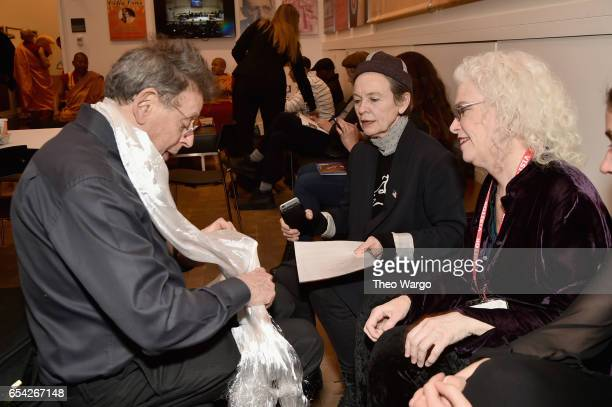 Philip Glass Laurie Anderson and Martha Mooke talk backstage during the Tibet House US 30th Anniversary Benefit Concert Gala to celebrate Philip...