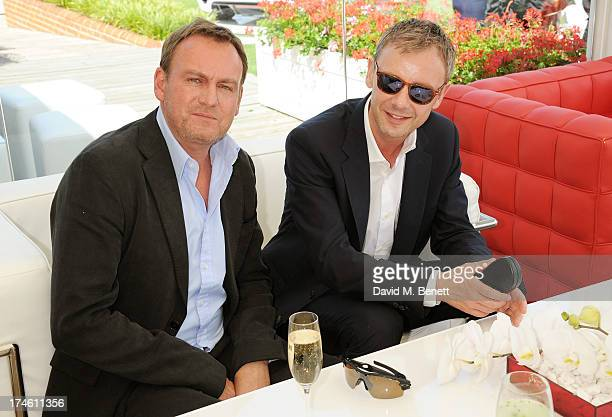 Philip Glenister and John Simm attend the Audi International Polo at Guards Polo Club on July 28 2013 in Egham England