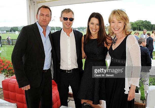 Philip Glenister John Simm Kate McGowan and Beth Goddard attend the Audi International Polo at Guards Polo Club on July 28 2013 in Egham England
