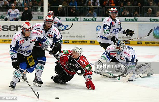 Philip Gogulla of Koeln and David Sulkovsky of Schwenningen battle for the puck during the DEL match between Koelner Haie and Schwenninger Wild Wings...