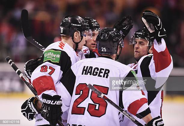 Philip Gogulla of Koelner Haie celebrates with team mates as he scores the third goal during the Ice Hockey DEL match between Duesseldorfer EG and...