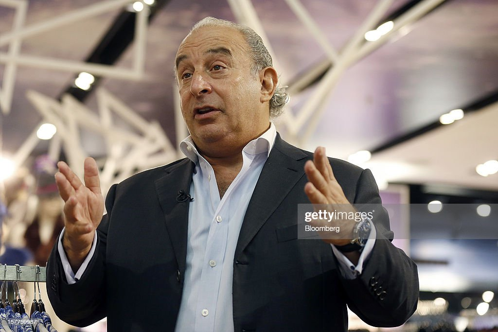 Philip Green, the billionaire owner of fashion retailer Arcadia Group Ltd., gestures during a Bloomberg Television interview inside a Topshop store on Oxford Street in London, U.K., on Thursday, Dec. 6, 2012. Green, the billionaire owner of the Arcadia fashion business, sold a 25 percent stake in the Topshop and Topman retail chains to Leonard Green & Partners LP, the co-owner of the J Crew fashion brand, in a deal valuing the businesses at 2 billion pounds ($3.2 billion). Photographer: Simon Dawson/Bloomberg via Getty Images Photographer: Simon Dawson/Bloomberg via Getty Images