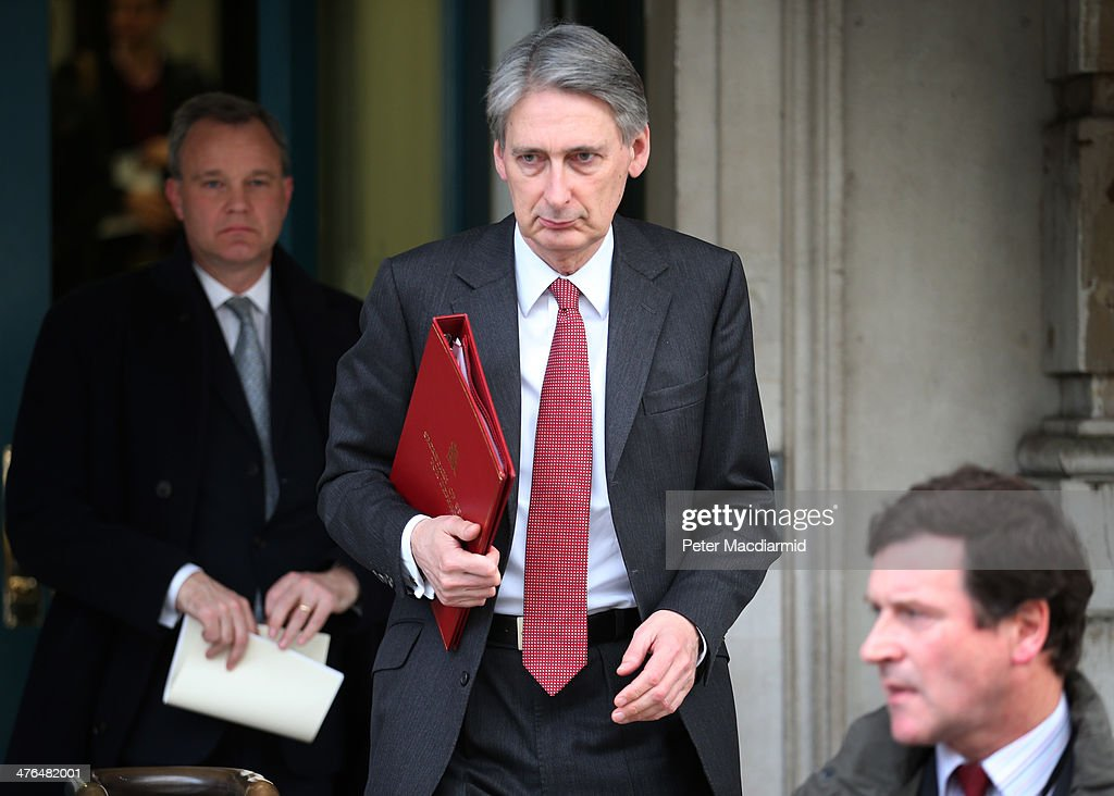 <a gi-track='captionPersonalityLinkClicked' href=/galleries/search?phrase=Philip+Hammond&family=editorial&specificpeople=2486715 ng-click='$event.stopPropagation()'>Philip Hammond</a>, Secretary of State for Defence, leaves the Cabinet Office after attending a National Security Council meeting on March 3, 2014 in London, England. Prime Minister David Cameron has held the meeting to discuss the situation in Ukraine.