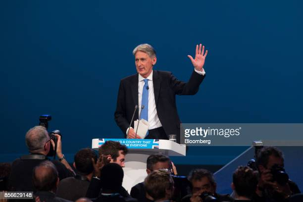 Philip Hammond UK chancellor of the exchequer acknowledges supporters after delivering his speech at the annual Conservative Party conference in...