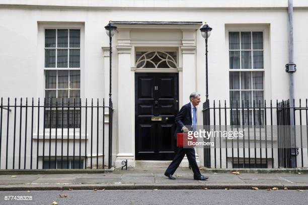 Philip Hammond UK chancellor of the exchequer carries the dispatch box containing the budget outside 11 Downing Street before presenting an annual...