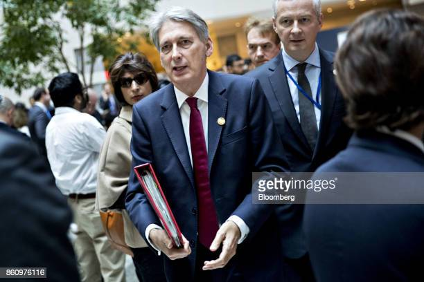 Philip Hammond UK chancellor of the exchequer leaves from a Group of 20 finance ministers and central bank governors meeting on the sidelines of the...