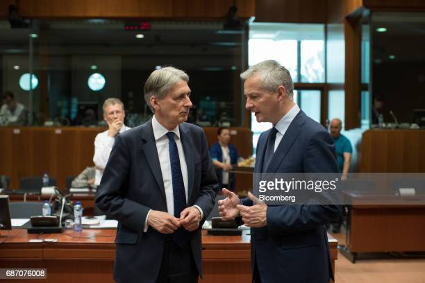 Philip Hammond UK chancellor of the exchequer left listens as Bruno Le Maire France's finance minister speaks ahead of an Ecofin meeting of European...