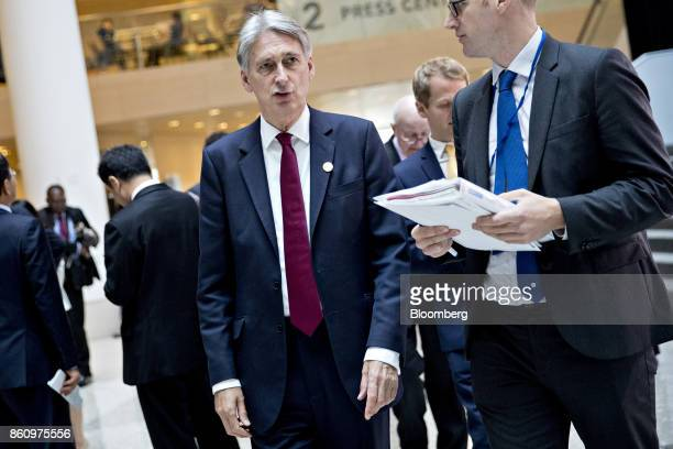 Philip Hammond UK chancellor of the exchequer left walks to a Group of 20 finance ministers and central bank governors meeting on the sidelines of...