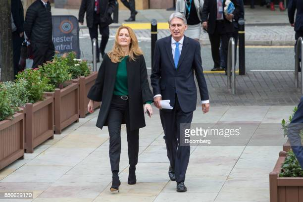 Philip Hammond UK chancellor of the exchequer right and his wife Susan WilliamsWalker arrive at the annual Conservative Party conference in...
