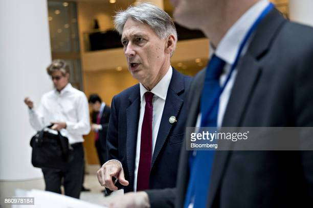 Philip Hammond UK chancellor of the exchequer walks to a Group of 20 finance ministers and central bank governors meeting on the sidelines of the...