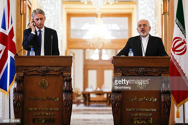 Philip Hammond UK foreign secretary left and Mohammad Javad Zarif Iran's foreign secretary attend a news conference following a meeting at the...