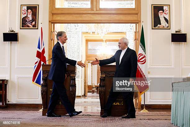 Philip Hammond UK foreign secretary left and Mohammad Javad Zarif Iran's foreign secretary shake hands following a news conference following a...