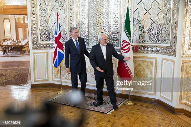 Philip Hammond UK foreign secretary left and Mohammad Javad Zarif Iran's foreign secretary greet each other before hosting a news conference...