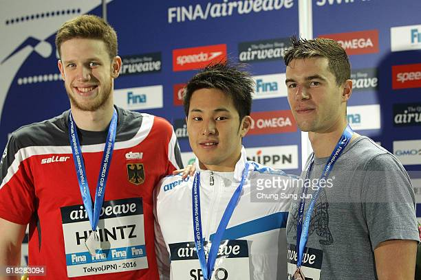 Philip Heintz of Germany Daiya Seto of Japan and Josh Prenot of United States pose on the podium after the Men's 200m Individual Medley final during...