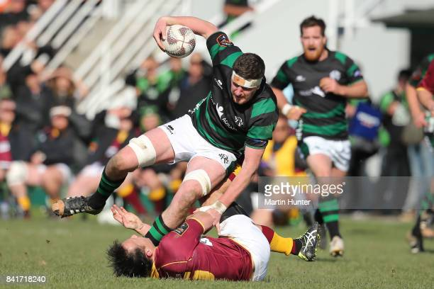 Philip Henderson of South Canterbury is tackled by Dean Church of King Country during the round two Heartland Championship match between South...