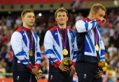 Philip Hindes Jason Kenny and Sir Chris Hoy of Great Britain celebrate with their gold medals during the medal ceremony after setting a new world...