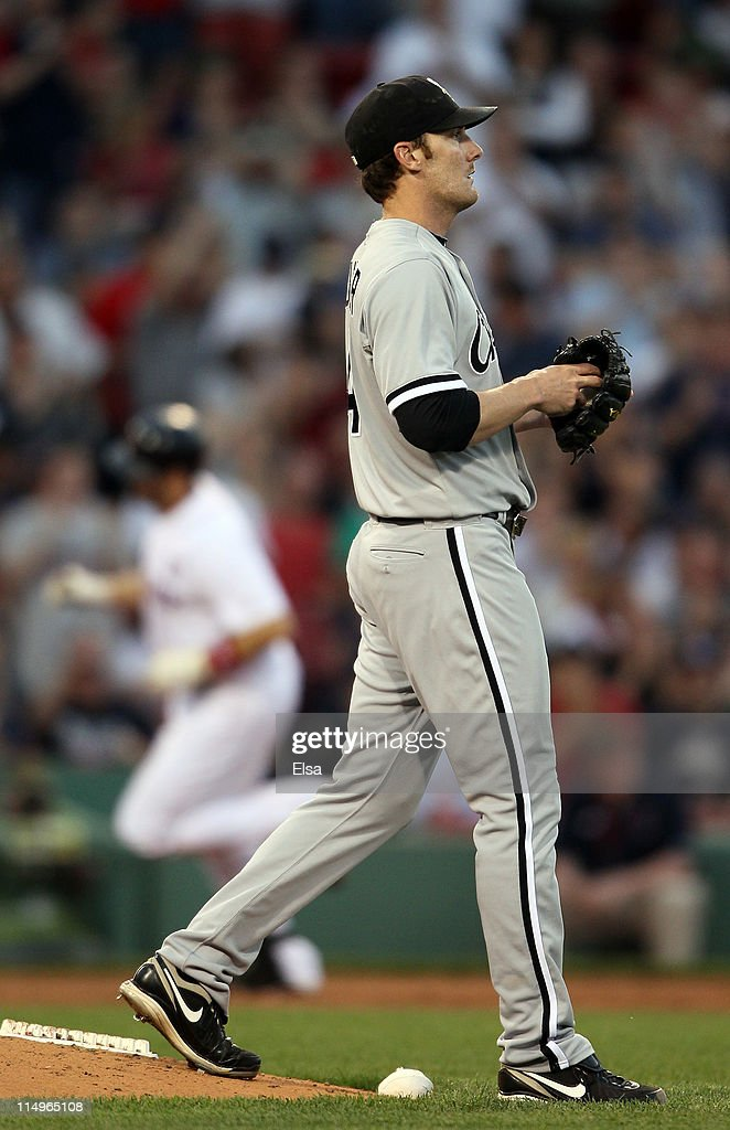 <a gi-track='captionPersonalityLinkClicked' href=/galleries/search?phrase=Philip+Humber&family=editorial&specificpeople=836505 ng-click='$event.stopPropagation()'>Philip Humber</a> #41 of the Chicago White Sox reacts as Jason Varitek #33 of the Boston Red Sox rounds the bases after his solo home run in the third inning on May 31, 2011 at Fenway Park in Boston, Massachusetts.