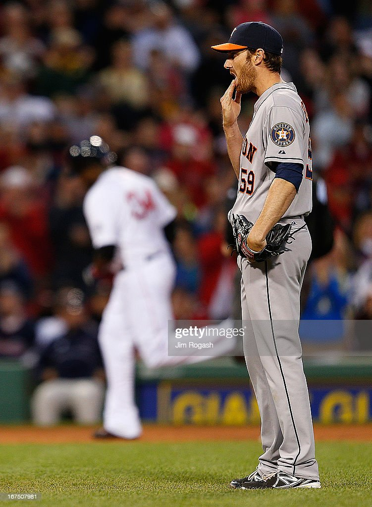 <a gi-track='captionPersonalityLinkClicked' href=/galleries/search?phrase=Philip+Humber&family=editorial&specificpeople=836505 ng-click='$event.stopPropagation()'>Philip Humber</a> #35 of the Houston Astros reacts after he gave up a home run to <a gi-track='captionPersonalityLinkClicked' href=/galleries/search?phrase=David+Ortiz&family=editorial&specificpeople=175825 ng-click='$event.stopPropagation()'>David Ortiz</a> #34 of the Boston Red Sox, seen rounding third base in the 3rd inning at Fenway Park on April 25, 2013 in Boston, Massachusetts.
