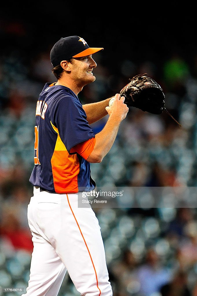 <a gi-track='captionPersonalityLinkClicked' href=/galleries/search?phrase=Philip+Humber&family=editorial&specificpeople=836505 ng-click='$event.stopPropagation()'>Philip Humber</a> #21 of the Houston Astros reacts to a pitch in the ninth inning against the Toronto Blue Jays during a game at Minute Maid Park on August 25, 2013 in Houston, Texas.